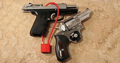 These are gun locks. For the record, you can get firearm locks FOR FREE from local law enforcement: http://www.projectchildsafe.org/
